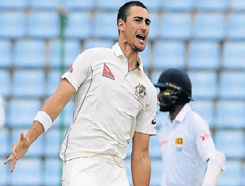 EARLY STRIKE: Australia's Mitchell Starc celebrates after he dismissed Sri Lanka's Kusal Perera during the second day of the opening test match at the Pallekele International Cricket Stadium yesterday. Picture: AFP