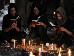 Iraqi women pray at the site of a suicide bombing that ripped through Baghdad's busy shopping district of Karrada on July 3. Picture: Ahmad al-Rubaye / AFP