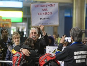 Friends and family of the Trek4Mandela climbers welcome the team home from Mount Kilimanjaro at OR Tambo International Airport Picture: Herman Verwey