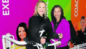 Curves Greenacres instructor, Linda van Staden, right, shows Micaela Meyer how to strengthen her glutes Picture: MIKE HOLMES