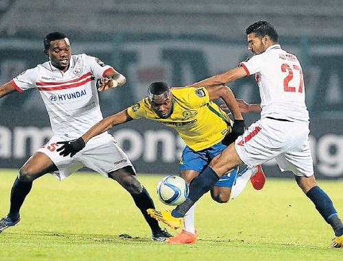 COMING THROUGH: Mamelodi Sundowns' Siyanda Zwane is challenged by Zamalek's Aly Aly, left, and Yusuf Maroof during their Caf Champions League match at the Lucas Moripe Stadium in Pretoria last night. Picture: GALLO IMAGES