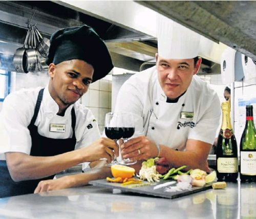 Up-and-coming chef Mthobeli Ndaleni, left, and Radisson Blu executive chef George Foley work on the delectably balanced menu