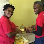 Zimasa Sani helps her colleague Zuko Mqaqa spread sandwiches at Mandela Day  Picture: Gillian McAinsh