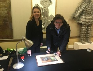 South African art specialists Kirsty Colledge and Alex Richards from auction house Strauss & Co examine a one of a kind Hugo Naude pastel drawing of an interior Cape Cottage scene valued at between R40 000 and R60 000  Picture: Devon Koen