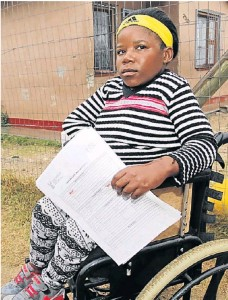 Vuyiswa Manqunyana, 24, with the title deed for her RDP house in Motherwell Picture: Brian Witbooi