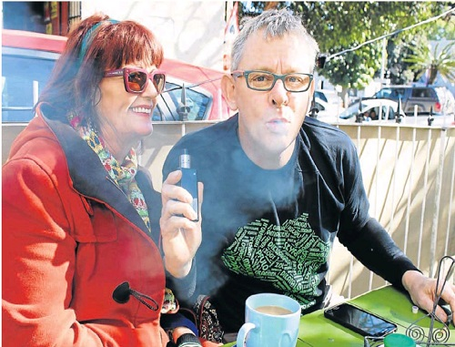 UP IN SMOKE: Dagga activist Jules Stobbs exhales a big cannabis oil hit from his vaporizer while partner Myrtle Clarke looks on at the National Arts Festival in Grahamstown. Pic: David Macgregor