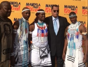 Martin Pram, of the Nelson Mandela Bay Arts Council, left, and mayor Danny Jordaan meet Qhama Africa Dancer members Msindi Mbotshana, Bulelwa Majali and Mkena du Preez