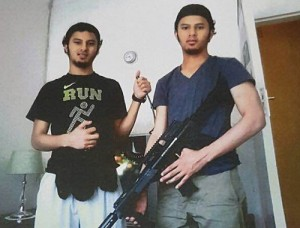 The Thulsie brothers with what appears to be a bomb, detonator and rifle