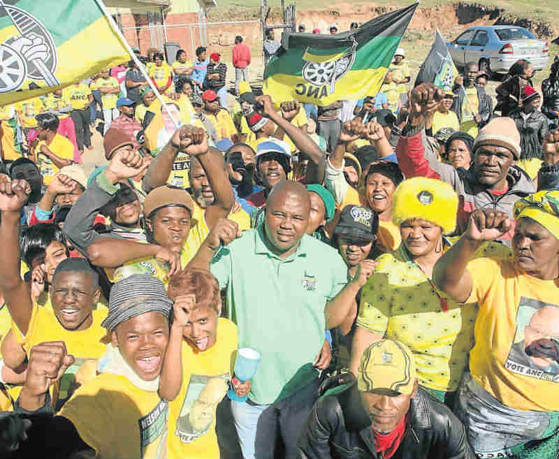 STRONG SUPPORT: Phakamisa Mfama, centre (in green), is surrounded by jubilant ANC supporters after winningWard 42 in Uitenhage. Picture: FREDLIN ADRIAAN