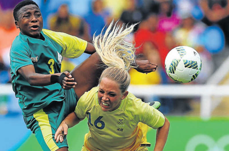 BALL DUEL: Sweden's Elin Rubensson collides with South African defender Nothando Vilakazi at the Olympic Stadium in Rio. Picture: GETTY IMAGES