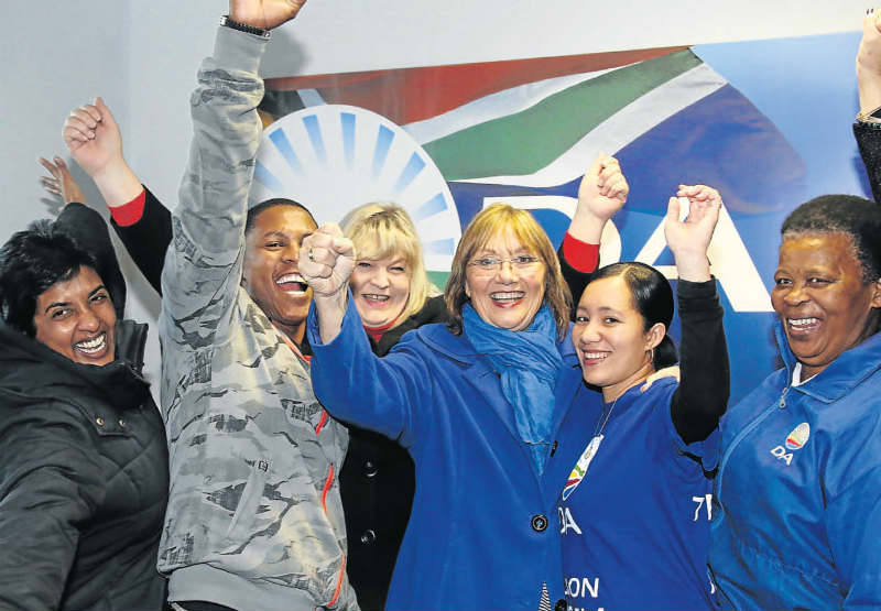 DID IT!: Kouga mayoral candidate Elza van Lingen, third fromright, celebrates with DAmembers. Pictures: EUGENE COETZEE