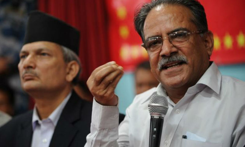 Unified Communist Party of Nepal (Maoist) Chairman Pushpa Kamal Dahal, also known as 'Prachanda' (R), and Prime Minister Baburam Bhattarai address a press conference in Kathmandu on July 22, 2012. File photo. Image by: AFP PHOTO/Prakash MATHEMA