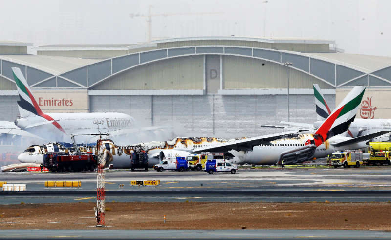 An Emirates airline Boeing 777-300 lays on the ground at Dubai International Airport after being gutted by fire due to a mechanical failure Picture:  EPA/STR