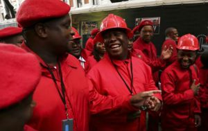 Economic Freedom Fighters leader Julius Malema, centre, and his fellow party members arrive in their distinctive uniforms to be sworn in as MPs in 2014. Picture: REUTERS/SUMAYA HISHAML