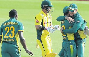 WELL DONE: Quinton de Kock and David Miller of the Proteas celebrate the wicket of Matthew Wade of Australia during the Momentum ODI Series match between SA and Australia yesterday  Picture: GALLO IMAGES