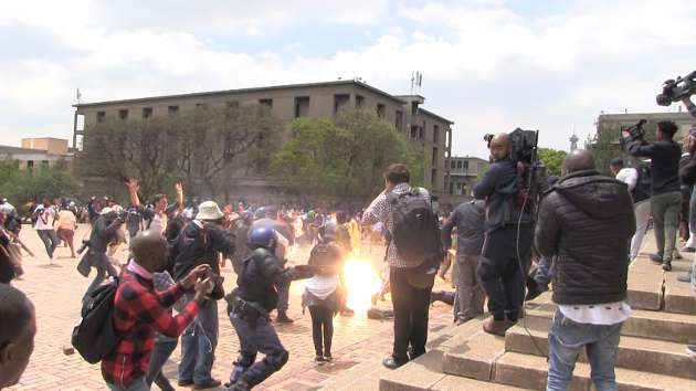 Police fired stun grenades and rubber bullets to disperse the crowd which had disrupted classes and had gathered outside the Great Hall in Wits's Braamfontein East campus Picture: Abigail Javier